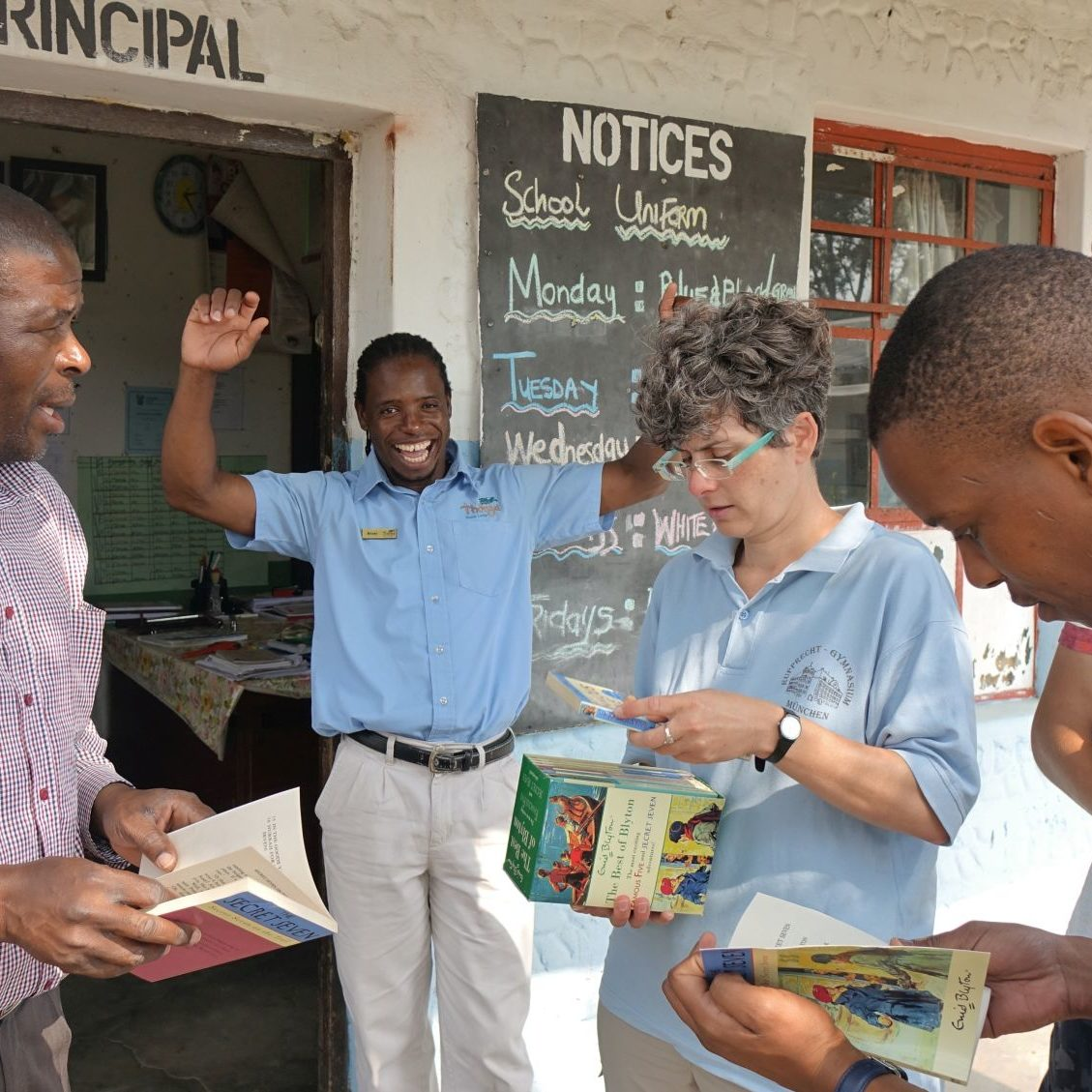 Harald, Nicola and Kilian Boedrich donated much needed books to Mabibi Primary School.